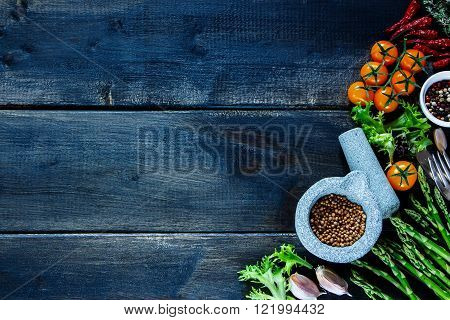 Rustic Table With Various Colorful Spices And Vegetables