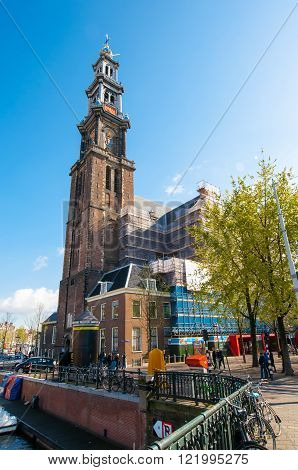 AMSTERDAM-APRIL 30: The belfry of the Westerkerk from the Prinsengracht canal on April 302015 the Netherlands. Westerkerk is a Dutch Protestant church located on the Prinsengracht canal.