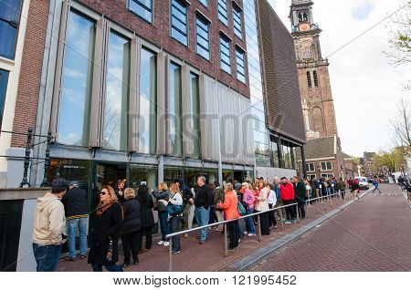 AMSTERDAM-APRIL 30: People queue up to the Anne Frank House Museum on April 302015.The Anne Frank House Museum is one of Amsterdam's most popular and important museums opened in 1960.