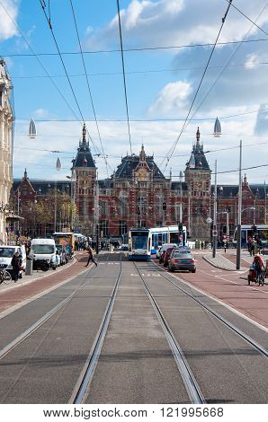 AMSTERDAM-APRIL 30: Rokin street with Amsterdam Central Station in the background on April 302015 in Amsterdam the Netherlands. Rokin is a major street in Amsterdam the Netherlands.