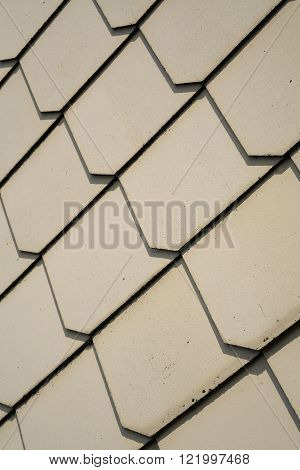 shingles as wall cladding on the facade of a house