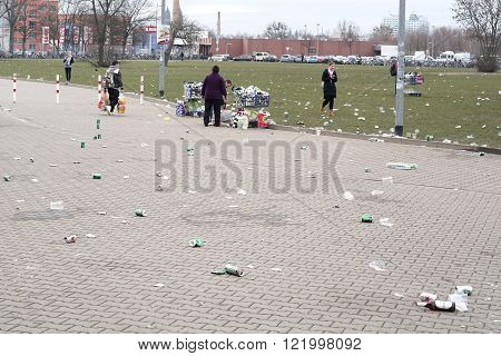 MAGDEBURG , GERMANY - MARCH 05, 2016: garbage problem in front of a soccer stadium during the football game 1.FC Magdeburg against FC Hansa Rostock in Magdeburg