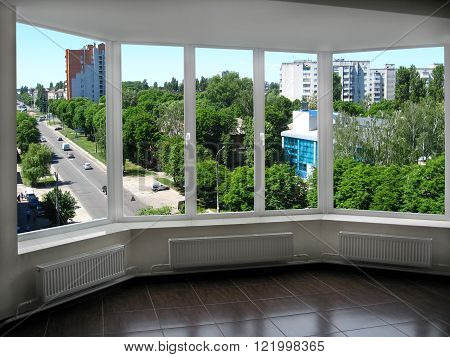 modern window to the boisterous street of city in summer