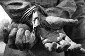 pic of whip-hand  - hands tied behind a prisoners hands in black and white - JPG