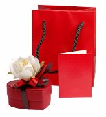 stock photo of valentine candy  - valentine still life with heart shape chocolate box with rose on it a red bag and a red card to put your message on it - JPG