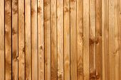 stock photo of wooden fence  - a wooden fence background with wood grain and knots - JPG