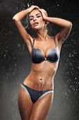 stock photo of flux  - Sexy brunette taking a shower - JPG
