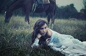 image of old-fashioned  - Fine art photo of a young beauty on the grass - JPG