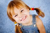 image of little girls  - Funny playful little girl on blue - JPG