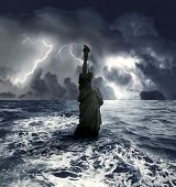 picture of american money  - statue of liberty sinking in the sea during a storm - JPG
