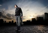 stock photo of young men  - Young man in street - JPG