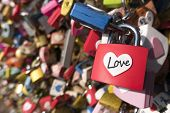 Постер, плакат: Love sign and romance concept Heart shaped love padlocks locked at landmark tourists place
