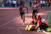 KUALA LUMPUR - AUGUST 18: Malaysia's visually impaired relay team runner falls after her run at the