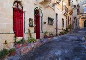 picture of olden days  - Old narrow town street of mediterranean town - JPG
