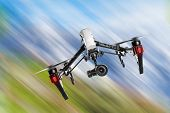 Modern drone in motion. Quadcopter with 4K camera flying. poster