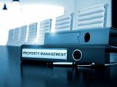 Property Management on Binder. Blurred Image. poster