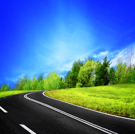 stock photo of long winding road  - The long and winding road in the mountain - JPG