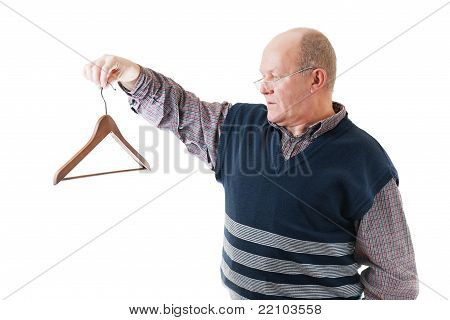 Confident Man In Glasses Holds In Hand Empty Cloth Hanger