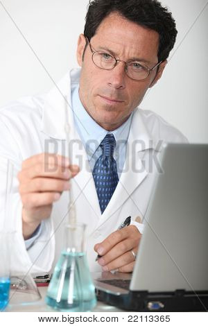 Lab technician analyzing test results