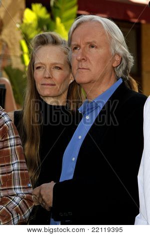 LOS ANGELES - DEC 18: James Cameron and wife Suzie Amis at a ceremony as James Cameron receives a star on the Hollywood Walk of Fame in Los Angeles, California on December 18, 2009