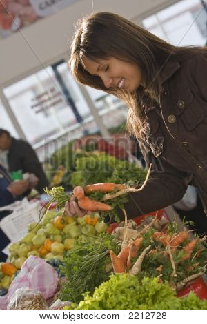 Woman In A Vegetable Market.