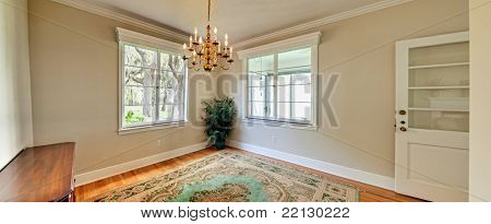 wide panorama of unfurnished diningroom with view windows