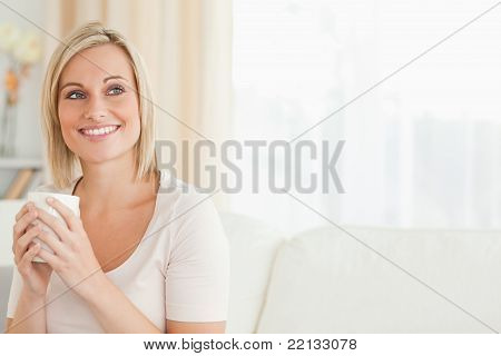 Smiling Woman Drinking Cup Of Tea