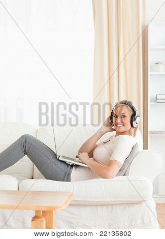 Portrait Of A Smling Woman With A Laptop And Headphones