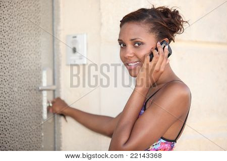 Woman unlocking her frontdoor
