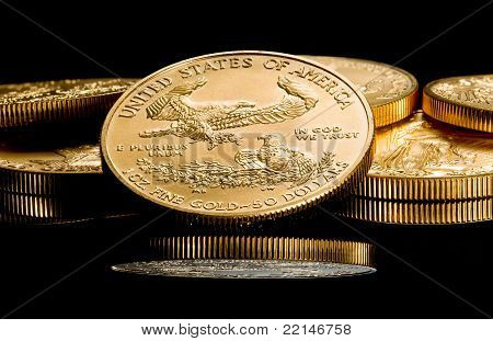 Macro Image Of Gold Eagle Coin On Stack