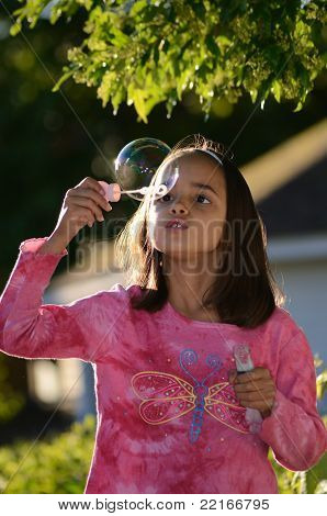 Girl Blows a Bubble