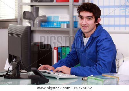Plumber typing at a computer
