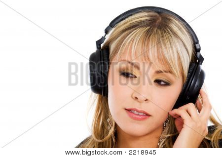 Blond Girl Listening To Music