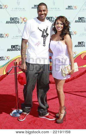 LOS ANGELES, CA - JUN 28: US basketball player Carmelo Anthony arrives with TV personality LaLa Vazquez at the BET Awards held at the Shrine Auditorium in Los Angeles, California 28 June 2009