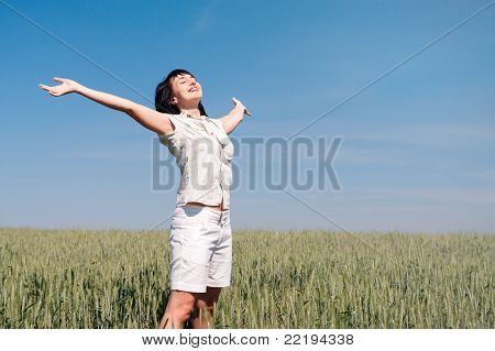 Happy Woman On The Wheat Field