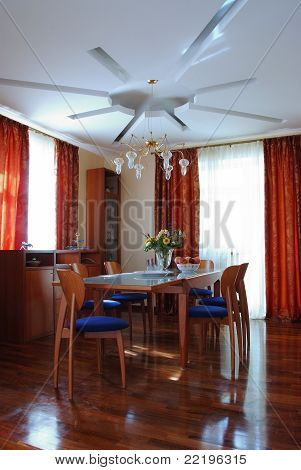Interior Of A Dining Room With Table And Chairs