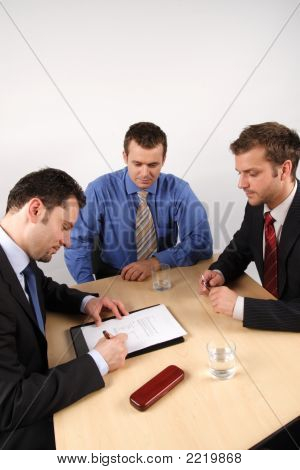 Three Business Men Handling Negotiations.