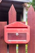 Red Mailbox On Fence poster