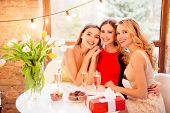 Three Pretty, Nice, Confident, Successful Girls Sitting In Restaurant, Embracing, Having Glasses Wit poster