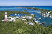 Aerial view of the harbour and lighthouse in Hope Town on Elbow Cay off the island of Abaco, Bahamas poster