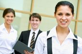 picture of crew cut  - Portrait of a young business lady and her team - JPG
