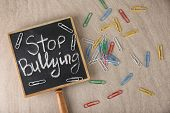 Chalkboard with text Stop bullying on light background poster