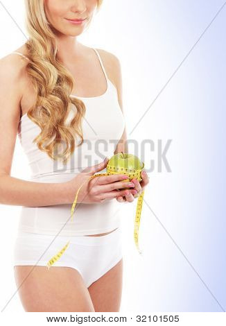 Young attractive sporty woman  isolated over white background