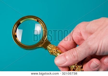 Magnifying Glass In Hand