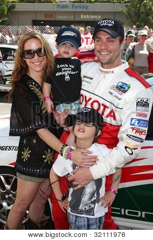 LOS ANGELES, CA - APR 16: Rachel Marcus Goddard, Daniel Goddard, Sons Sebastian & Ford at the Toyota Grand Prix Pro Celeb Race at Toyota Grand Prix Track on April 16, 2011 in Long Beach, California