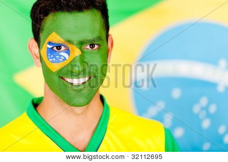 Portrait of a Brazilian man smiling with face painted