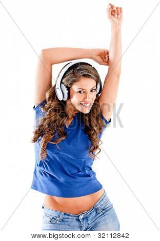 Beautiful woman listening to music - isolated over a white background