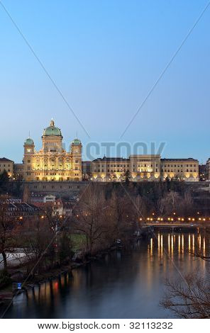 The Federal Palace Of Switzerland Behind Aar River At Dusk
