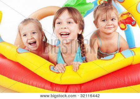 Children playing in swimming pool studio shot