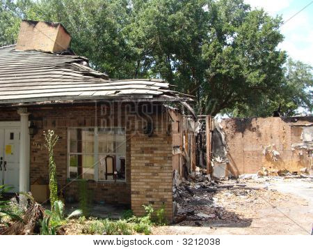 Fire Damaged Home With Driveway